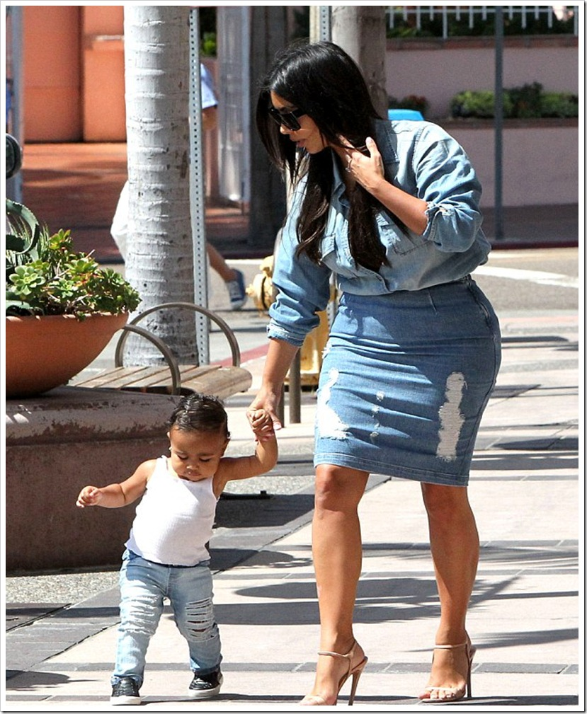 Kim Kardashian With Her One-Year-Old North In Ripped Denim